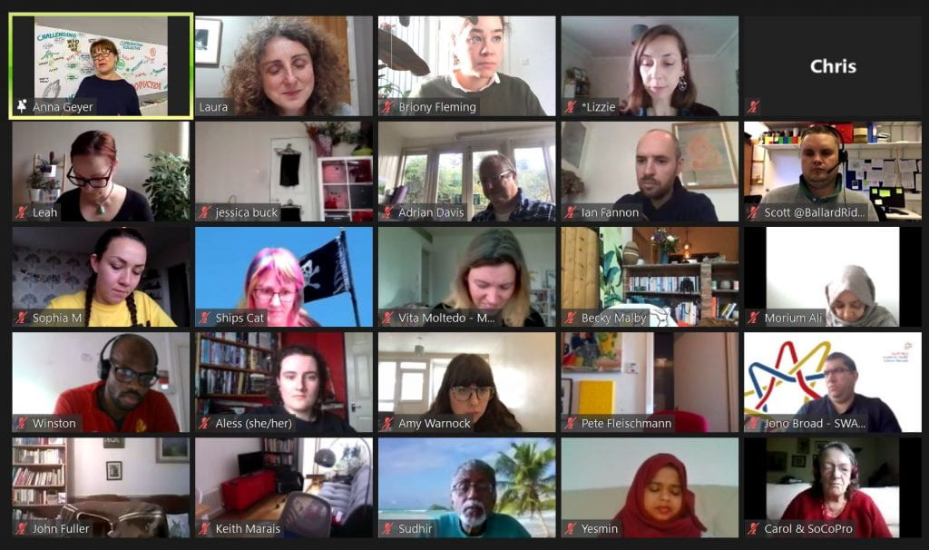 Zoom call screenshot with lots of faces listening to a talk