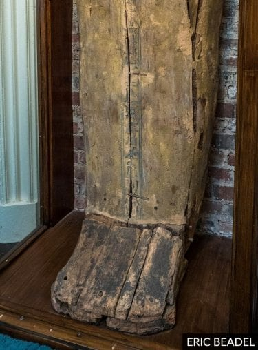 Lower part of the coffin lid showing preserved hieroglyphic text and largely 'invisible' name on foot panel.