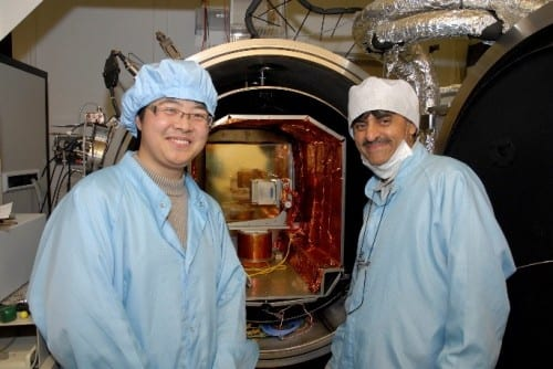 Dhiren Kataria (right), the MSSL detector physicist behind the QB50 INMS instrument. Behind him, the CHaPS payload for the forthcoming TechDemoSat mission (based on the same technologies as QB50 INMS) being prepared for testing in a calibration chamber