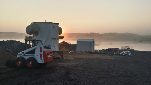 The CHIPS-M detector at dawn, on the day it was deployed in the flooded mine pit in the background. Photo courtesy Jerry Meier (University of Minnesota)