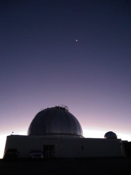 The telescope at dawn, with crescent moon. Photo: Patrick Owen