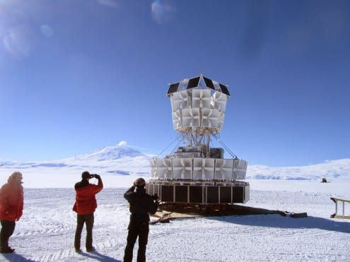 ANITA prior to being attached to the balloon. In the background, Mount Erberus, the second-highest volcano in Antarctica