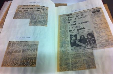 photograph of newspaper articles pasted into a book