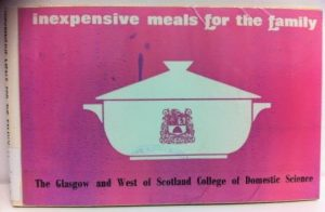 """photograph of front cover of book entitled """"inexpensive meals for the family"""" with graphic of a white casserole dish on a pink background"""