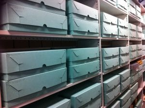 rows of green archive boxes on the shelves in the Archives Store
