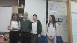 Singing 'Three Craws sat upon a wall.'