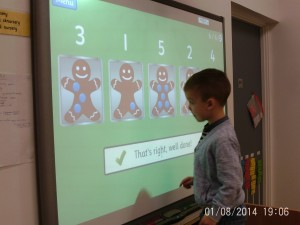 We have been busy this week playing in the heuristic room, counting and matching on the smartboard. The children have also been very creative with the blocks, building Santa Lands and castles.