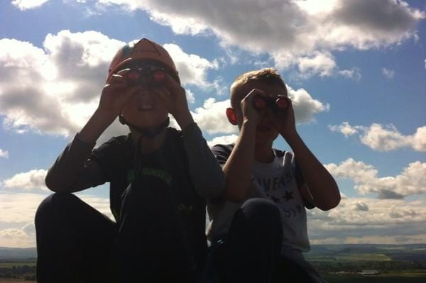 Two children viewing binoculars