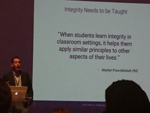 """Slide on screen saying """"When students learn integrity in lassroom settings, it helps them apply similar principles to other aspects of their lives"""""""