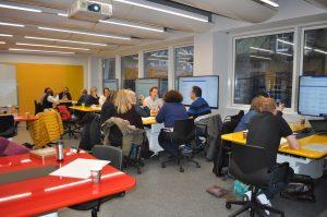 Groups discussing rubrics