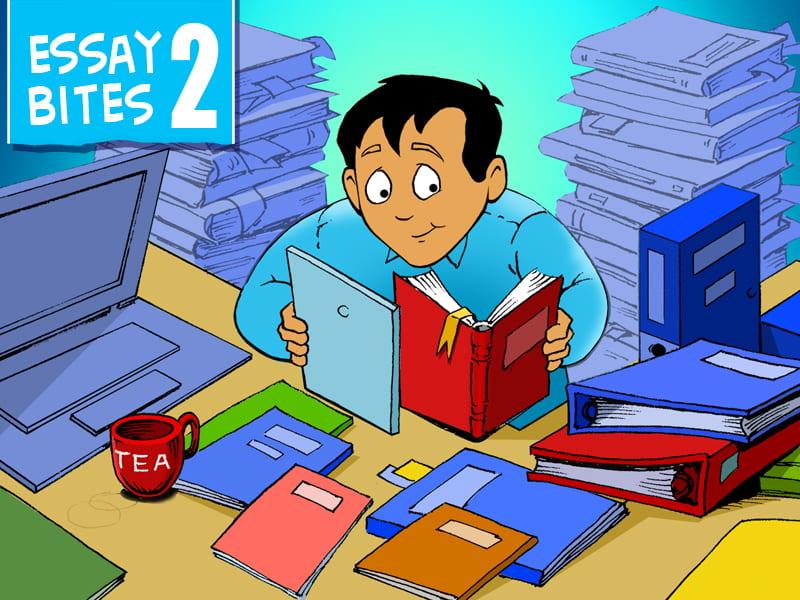 Student studying hard amongst stacks of books