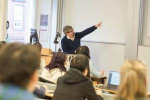 Teacher in classroom pointing