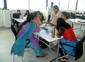 Students and tutors debating issues on the Bangalore course