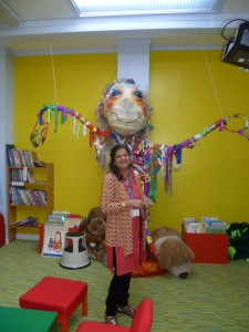 Anita overwhelmed by a giant puppet made by children