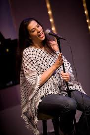 Maysoon Zayid a comedian who happens to have cerebral palsy, happens to be Palestinian and happens to be a woman