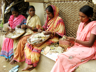 Women rolling beedis and hoping to make enough money to send their children to school.