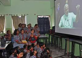 Children listen to the words of Prime Minister Narendra Modi