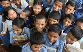 These smiling faces indicate the educational progress being made in Bangladesh