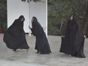 Three weird sisters cavort their evil way around the stage