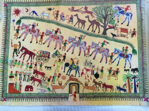 A Gujerati tribal painting on canvas portrays the bustle of village life