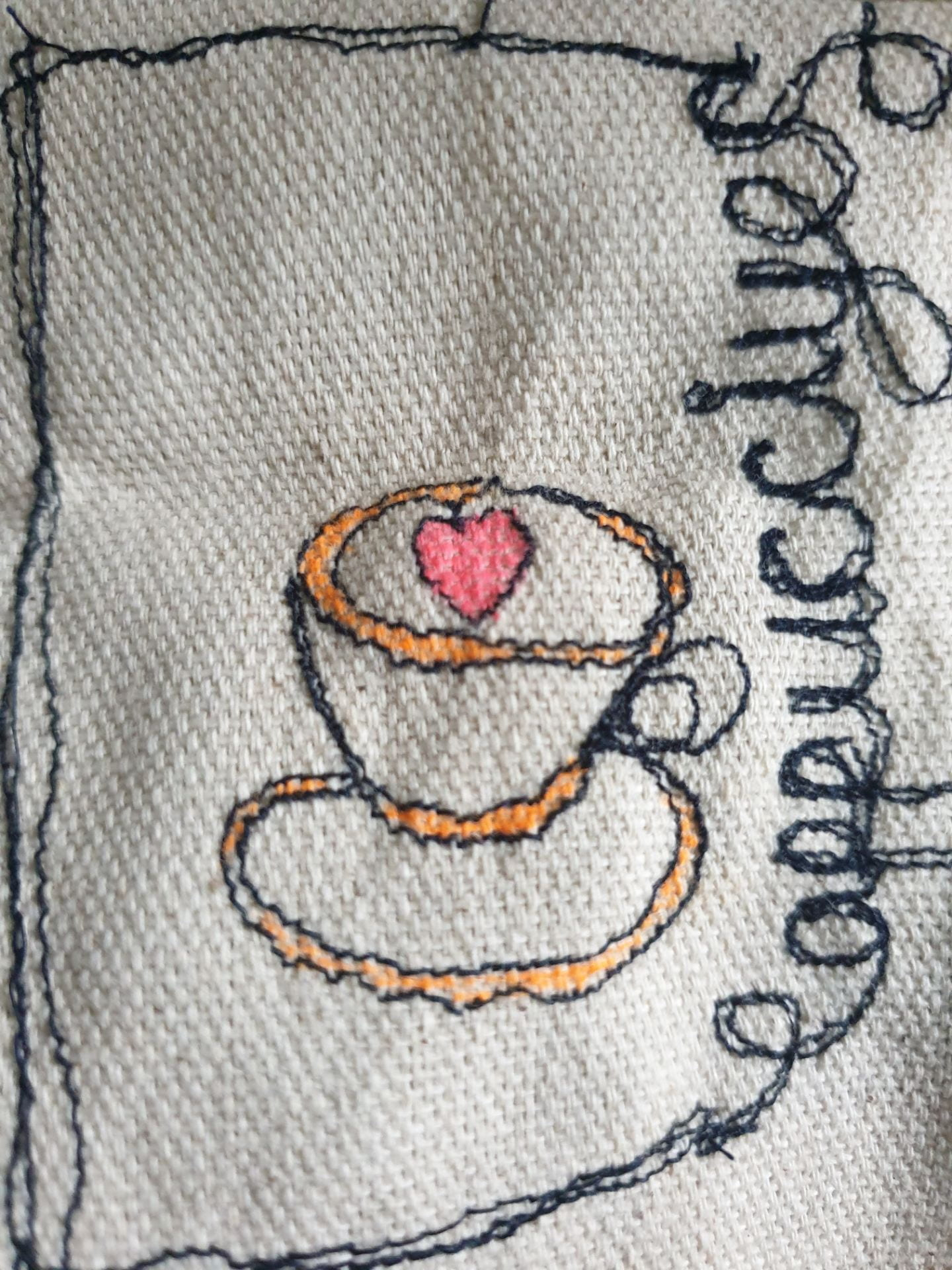 Embroidery showing a tea cup