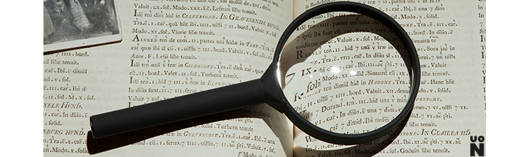 Magnifying glass on a text book