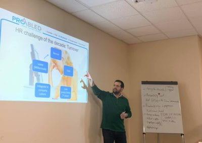 Samer Sfeir facilitating the workshop, slide about HR challenges