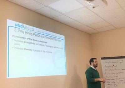 Samer Sfeir facilitating the workshop, slide about why hiring PWDs