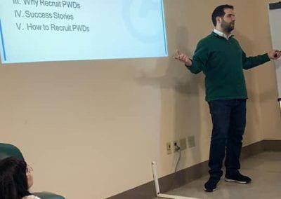 Samer Sfeir going over the agenda slide