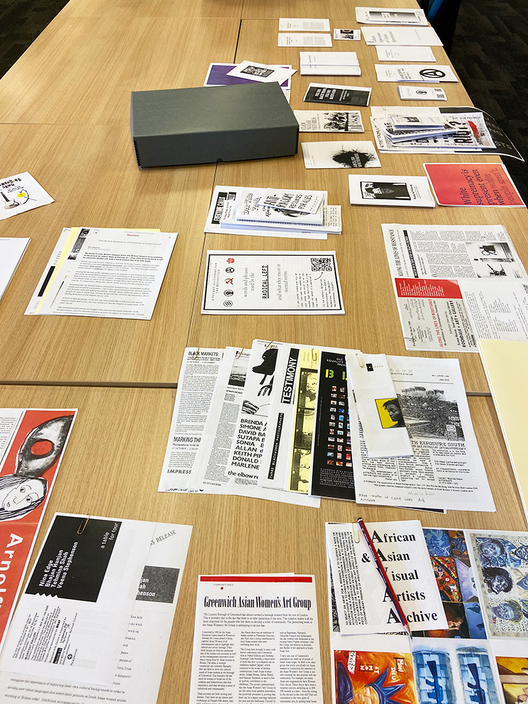 sheets of photocopied pamphlets and ephemera laid out on the table