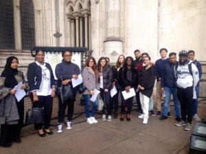 Goldsmiths LLB Law students at the Royal Courts of Justice, holding written guidance about their role as defence and prosecution counsel, judge, member of the jury, defendant and other parties in the criminal trial.