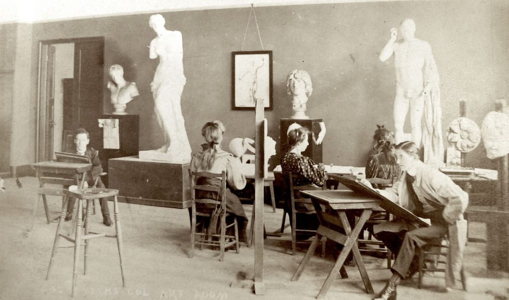Black and white photograph of Art students at Goldsmiths sketching in a studio of the Blomfield Building in 1908.