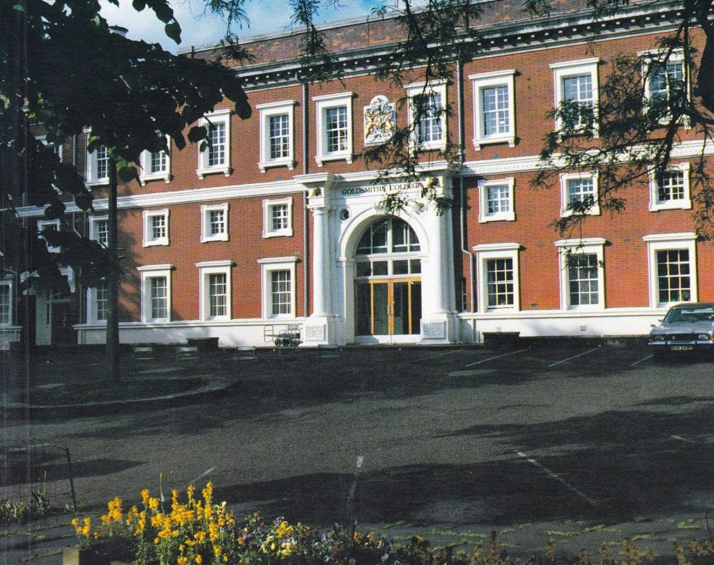 Colour photograph of the front of Goldsmiths' College main building around 1990 with a car parked far right.