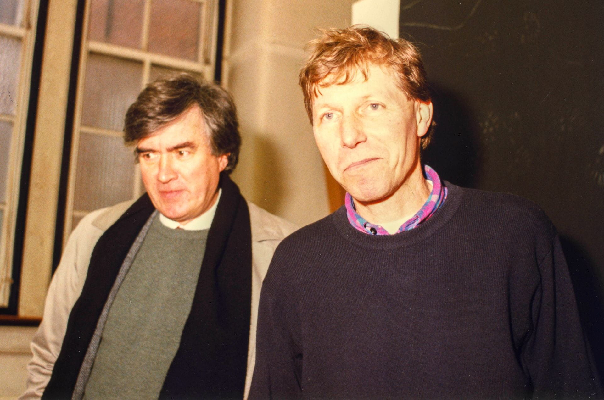 Portrait of Ian Jeffrey and Nigel Perkins together in Goldsmiths College main building studio in 1996. Ian is wearing a black scarf around his shoulders. Nigel is wearing a sweater.