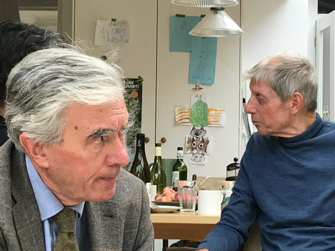Portrait of Ian Jeffrey and Nigel Perkins in September 2019. Ian is looking right forefront. Nigel is looking left further back.