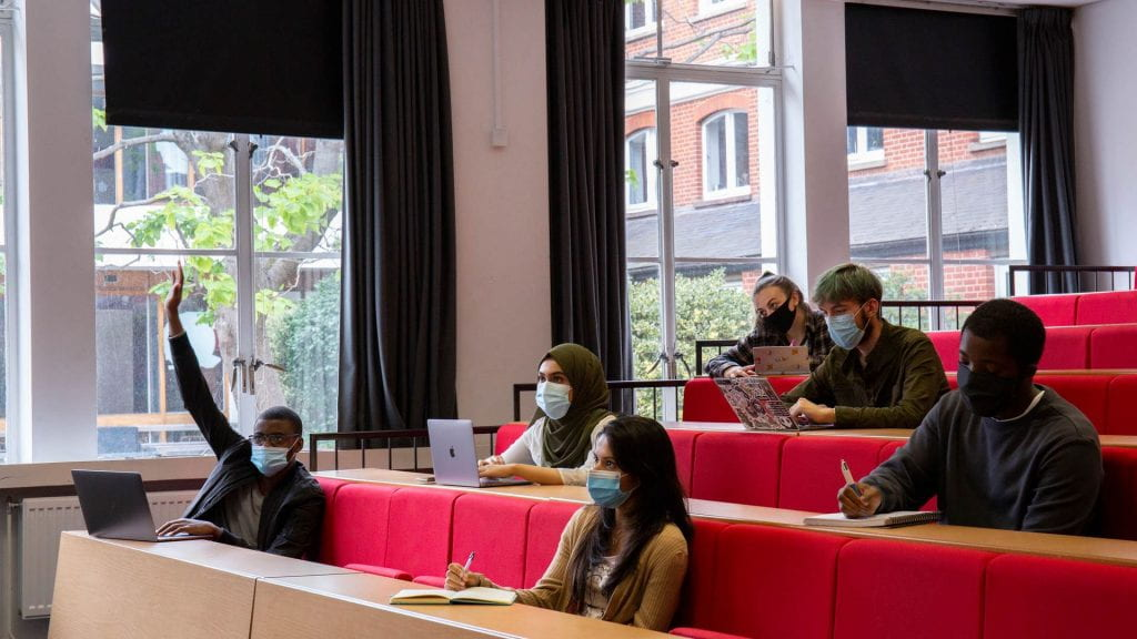 Students sit in a socially-distanced lecture theatre