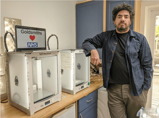 Dr Theo Papatheodorou from the Department of Computing stands next to Goldsmiths' 3d printers