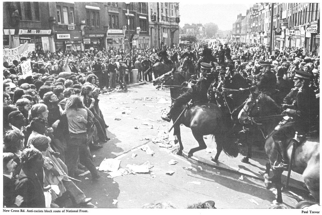 Anti-racists block the route of the NF march, New Cross Road, 13 Aug. 1977 (© Paul Trevor)