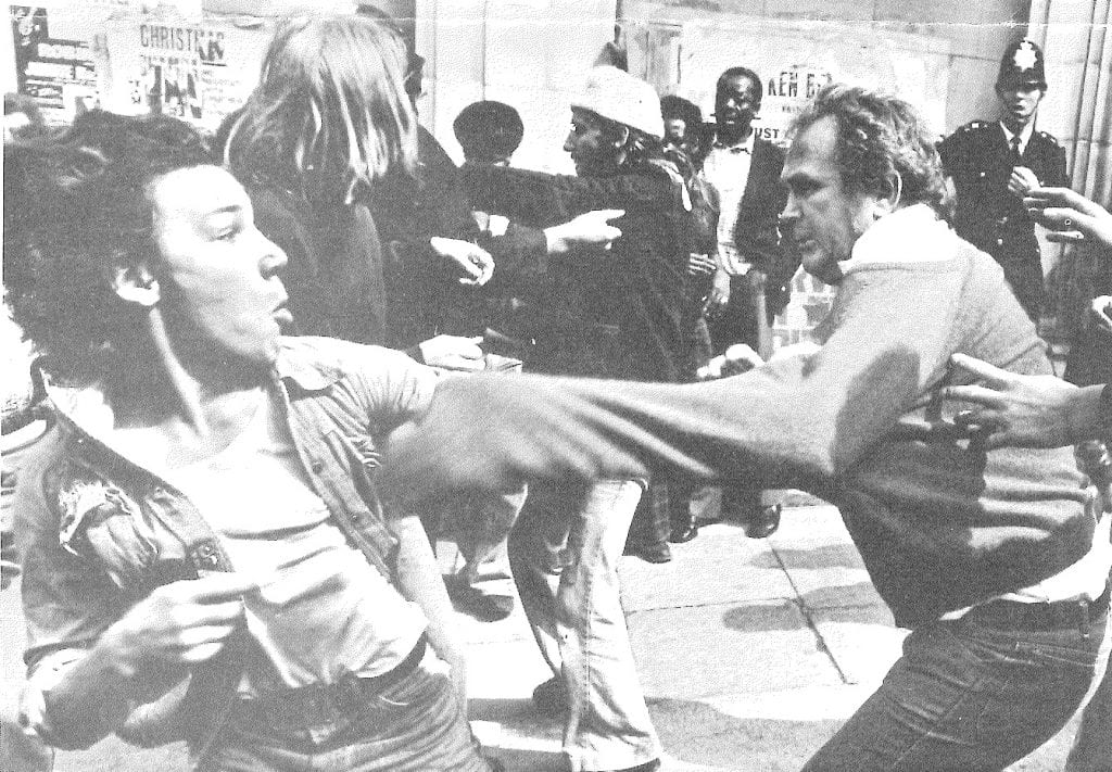 Anti-racist (left) fends off attack from NF supporters, Clifton Rise, 13 Aug. 1977 (© Peter Marlow)