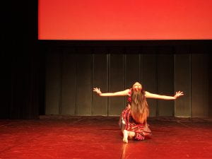 Photo of Yiyun performing Hair Swinging Dance in France