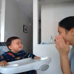 Mom and baby play peekaboo.