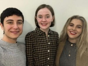 Ariel, Grace and Yasmine all smile at the camera
