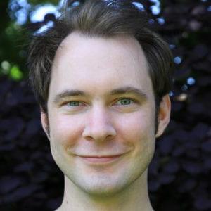 Headshot of Dr Adam Alston