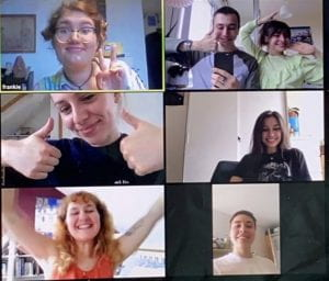 A screenshot of a zoom call between members of Seven Veils Collective. They all look into the camera and smile.