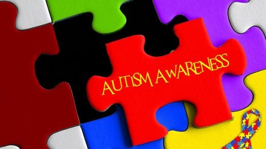 Image shows a jigsaw with the words autism awareness written on it