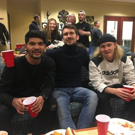 Image showing the SU president at a superbowl party