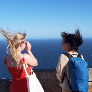 rebecca and coworker looking out to sea
