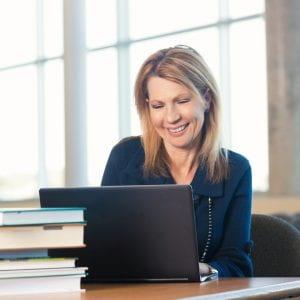 mature student using a laptop