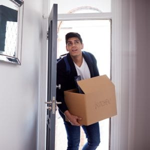 male student moving into student accommodation