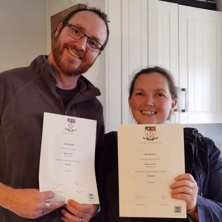 Dave Nicholls and his wife with their Master's certificates from Marjon University Cornwall